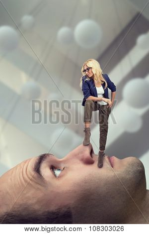 Young confident psychoanalyst standing on the man's face