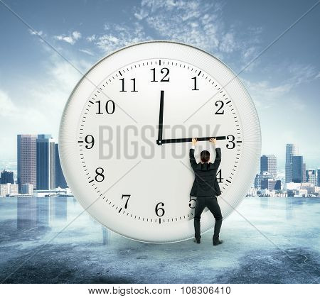 Businessman Trying To Stop The Time At City View Background, Stop The Time Concept