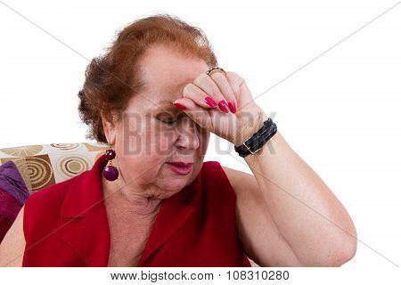 Senior Lady Suffering From A Headache