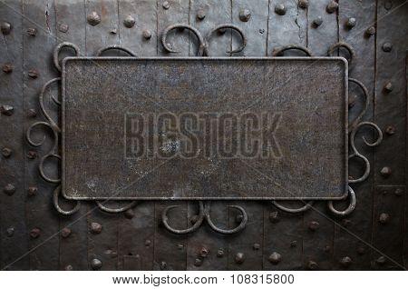 metal sign plate on old medieval door