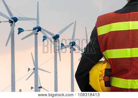 Hand Or Arm Of Engineer Hold Yellow Plastic Helmet