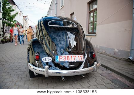 VW Beetle Cabriolet 1957 on the street