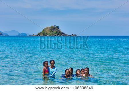 Nacapan Palawan Philippines-April 5, 2015 :filippino natives people bathing on a island between El Nido and coron in Palawan Philippines