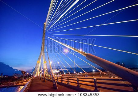 The Rama VIII Bridge is a cable stayed bridge crossing the Chao Phraya River in Bangkok Thailand poster