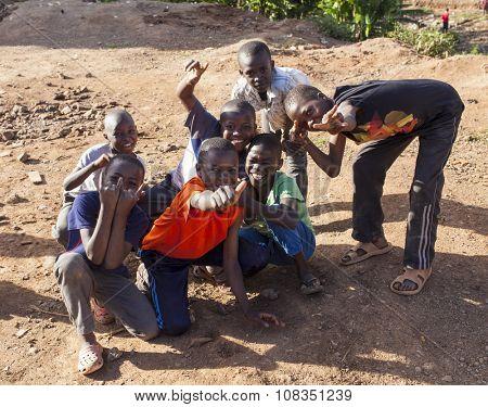 Nairobi, Kenya- November 9, 2015: Kenyan children playing in Nairobi, just outside the Kibera slum. Despite poverty, these kids have fun.