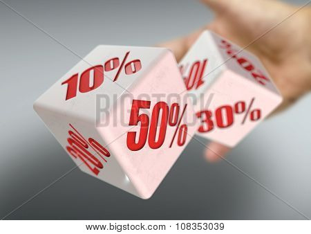 Hand Throwing Two Dice Rolling. Percentage Savings On Each Face. Discount, Deal, Sale, Save Money