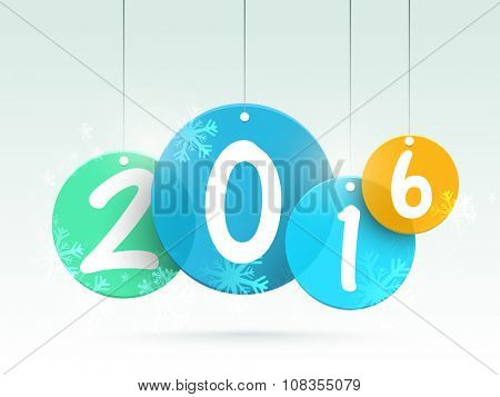 Stylish text 2016 on hanging tags with snowflakes for Happy New Year celebration.