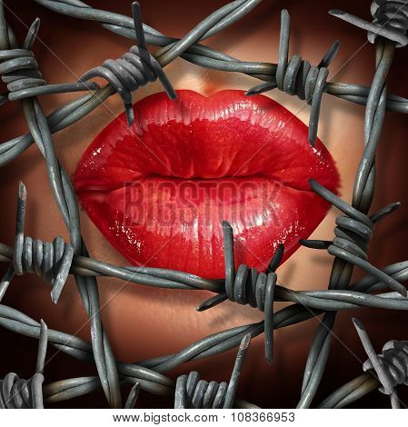 Cosmetic beauty product restrictions concept or banned relationship symbol as female lips with red lipstick behing hazardous barbed or barb wire as a metaphor for restricted and prohibited human love.