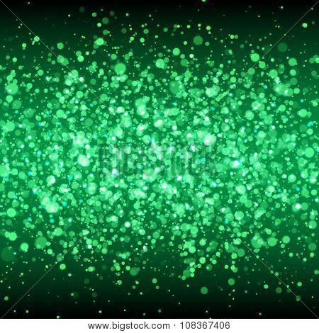 Green glittering flare sparkles. Spangled stardust background.