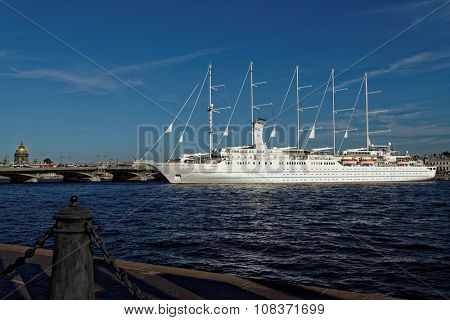 ST. PETERSBURG, RUSSIA - AUGUST 5, 2015: Cruise liner Wind Surf of Windstar Cruises Luxury Lines departs from the Neva river. The 5-masts ship provides luxury cruise for 310 guests