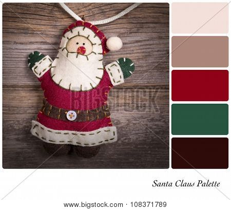 Retro style felt Santa Claus over old wood background. In a colour palette with complimentary colour swatches.