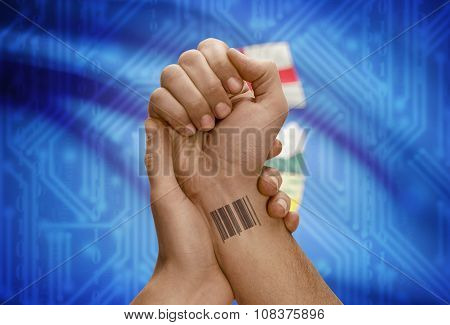 Barcode Id Number On Wrist Of Dark Skin Person And Canadian Province Flag On Background - Alberta