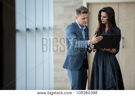 Business portrait of business couple.