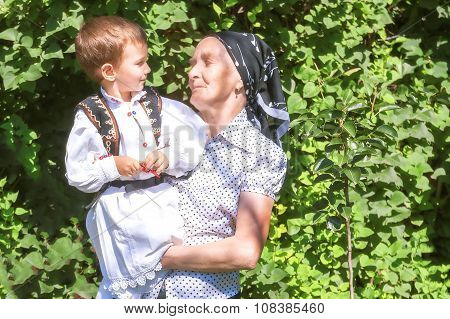 Great Grandmother Holding Her Grandson