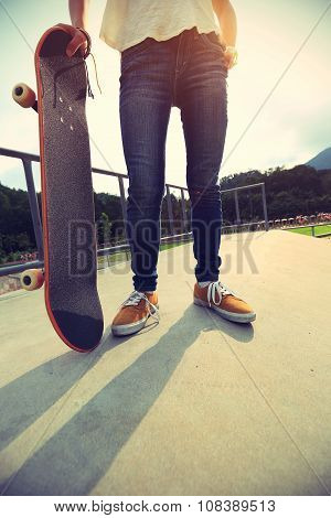 young woman skateboarder with skateboard