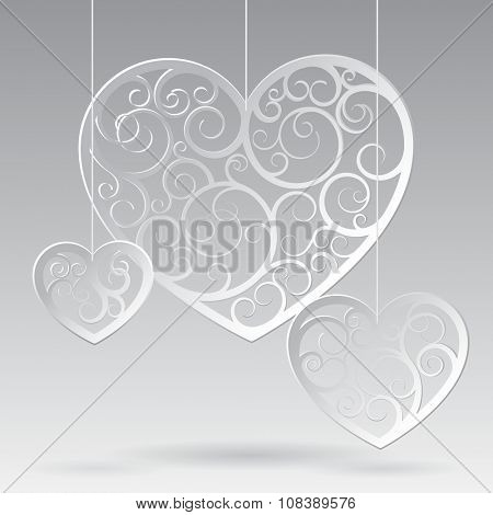 Paper suspended patterned hearts of different forms against a white background. Valentine greeting card. Vector illustration