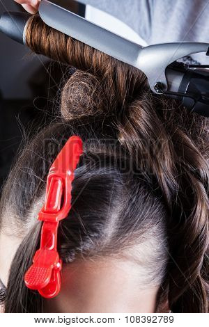 manufacturing hairstyle curling in a hairdressing salon