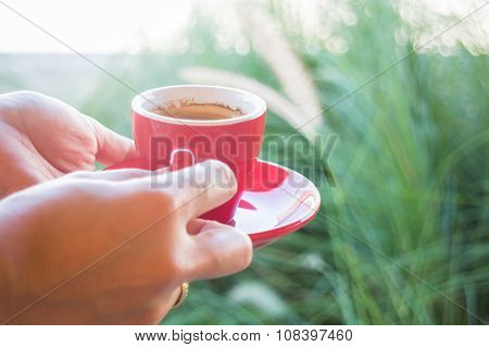 Woman Holds A Red Coffee Cup (vintage Style Color)