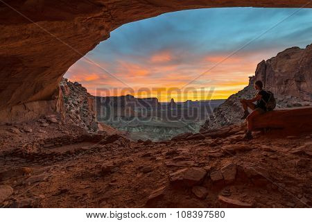 Girl Backpacker Looking At Beautiful Sunset