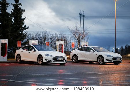 Two Tesla Model S Cars Plugged In At Supercharger Station