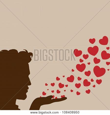 Man blowing hearts vector