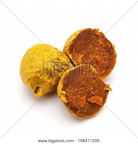 Macro closeup of a full and a cracked Organic Round Turmeric.