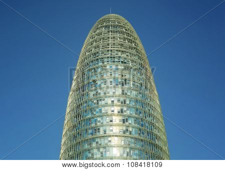 Architectural detail of the Agbar Tower Barcelona, against blue sky