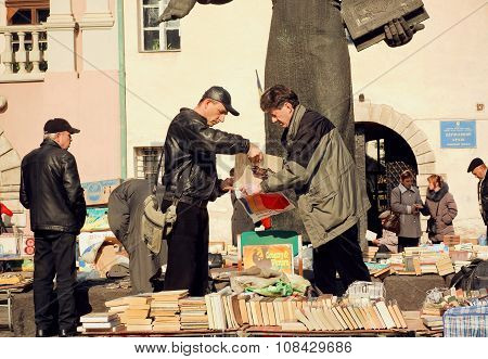 People Buying Vynil Records And Vintage Books On The Flea Market
