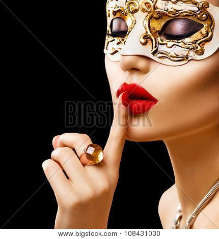 Beauty model woman wearing venetian masquerade carnival mask at party isolated on black background  Christmas and New Year celebration. Glamour lady with perfect make up and accessories