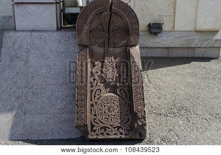 The broken stone with carved openwork cross
