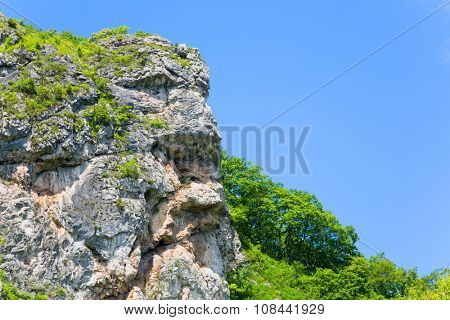 Natural rock in the shape of a human head allocated to the mountain range. Far East, Russia. poster