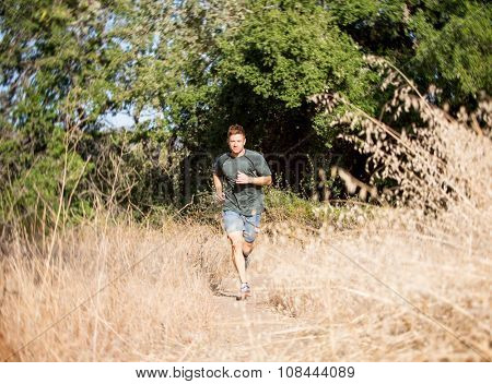 trail running athlete exercising outdoors on mountain pathway