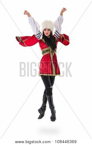 Young woman wearing a folk costumes jumping.  Isolated on white background in full length with copyspace poster