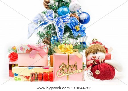 Christmas Greeting Santa With Gifts Front Of A Christmas Tree And Snow Mountain