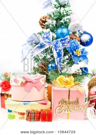 Christmas Greeting Gifts Front Of A Christmas Tree And Snow Mountain