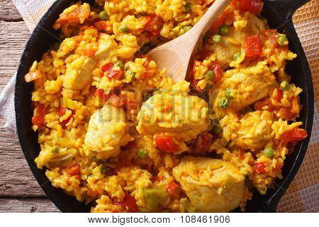 Hispanic Cuisine: Arroz Con Pollo Closeup In A Pan. Horizontal Top View