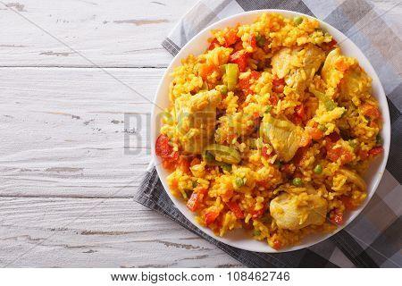Hispanic Cuisine: Arroz Con Pollo Close Up In A Bowl. Horizontal Top View