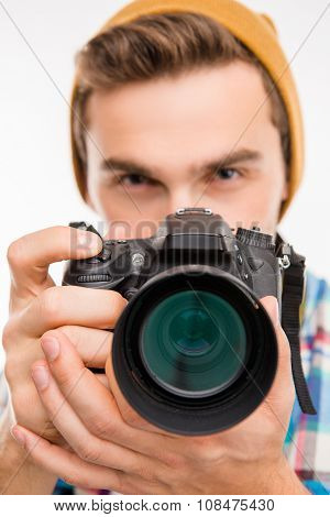 Closeup Photo Of A Photographer With Hat Taking A Photo