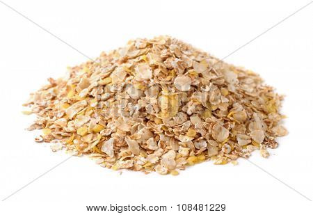 Heap of multi grain flakes isolated on white