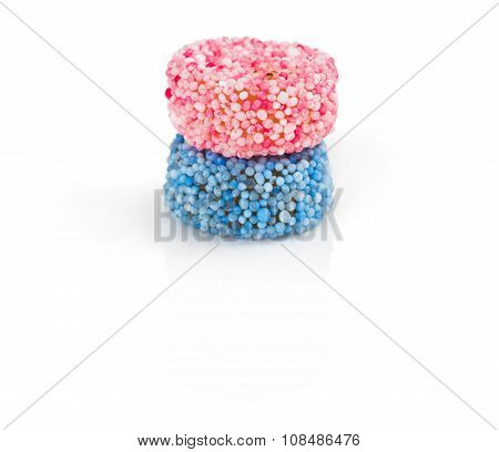 Two liquorice allsorts candy isolated on white background
