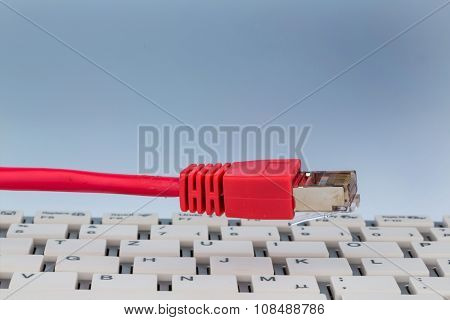 network cable on keyboard, symbol photo for flatrate, e-commerce, global communications