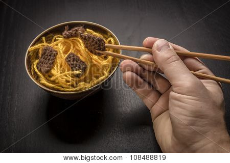 Food Knitted From Woolen Thread Lies On A Plate, As A Chinese Dish Of Noodles And Meat, The Human Ha