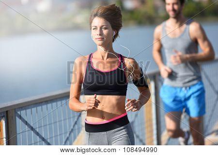 Couple running on riverside poster