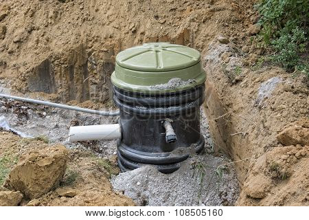Installation Of A Grinder Pump Holding Tank poster