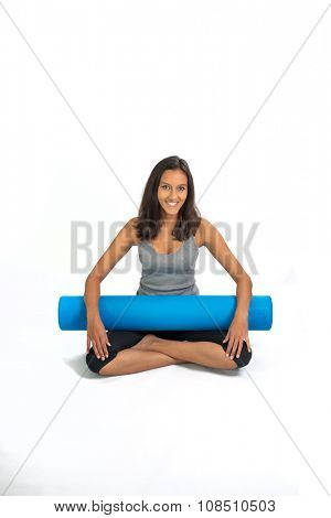 Young woman ready to do Fascia Training holding a Fascia Roll. Fascia Training describes sports activities that attempt to improve the functional properties of the muscular connective tissues.