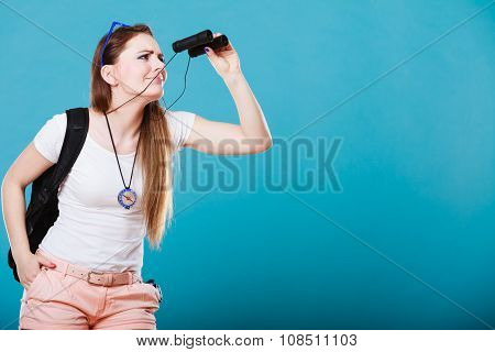 Tourist Woman Looking Through Binoculars On Blue