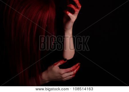 Woman With Blood On Hands And Red Hair Against Black Background, Unrecognisable