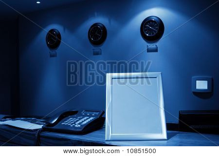 Reception Desk With Phone And Row Of Clock, Monochromatic