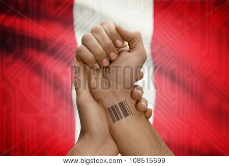 Barcode Id Number On Wrist Of Dark Skinned Person And National Flag On Background - Peru