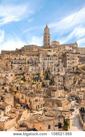 panoramic view of typical stones (Sassi di Matera) and church of Matera UNESCO European Capital of Culture 2019 under blue sky. Basilicata Italy poster